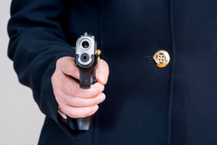 Woman pointing a hand gun Royalty Free Stock Images