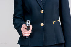 Woman pointing a hand gun Stock Image