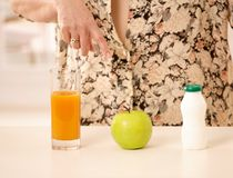 Woman pointing at healthy food stock image