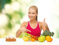 Woman pointing at healthy food Royalty Free Stock Images