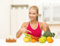 Woman pointing at healthy food Royalty Free Stock Photos