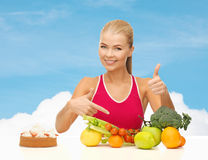 Woman pointing at healthy food Stock Photos