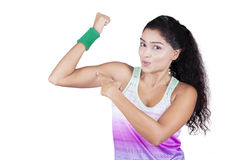 Woman pointing at her bicep Stock Photography