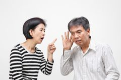 Woman pointing her finger against and blame her husband. Isolated on white background stock image
