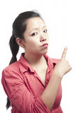 Woman Pointing her Finger Backward Royalty Free Stock Photography