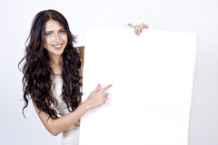 Woman pointing her finger on the empty sheet Stock Photo