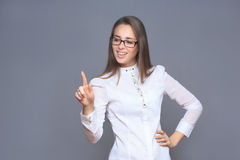 Woman pointing her finger on imaginery button Stock Images