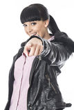 Woman Pointing Her Finger Straight on Whilst Smiling Royalty Free Stock Photo