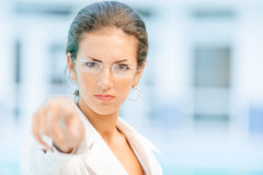 Woman pointing her finger to you Stock Photos