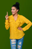 Woman pointing her finger up Royalty Free Stock Photography
