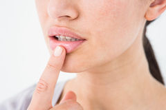 Woman pointing her lip Stock Image