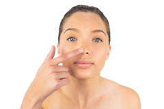 Woman pointing on her nose Royalty Free Stock Images