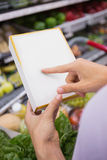 Woman pointing her shopping list Royalty Free Stock Photo