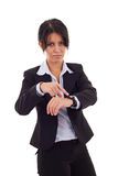 Woman pointing her watch Stock Image