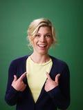 Woman pointing at herself, studio shot Royalty Free Stock Image