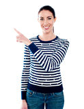 Woman pointing index finger at something Royalty Free Stock Images