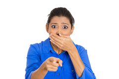 Woman pointing with index finger, stunned Stock Photo
