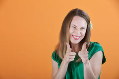 Woman Pointing Index Fingers Royalty Free Stock Photography