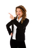 Woman pointing isolated on white background Stock Photo