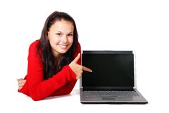 Woman pointing at laptop Royalty Free Stock Photos