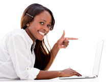 Woman pointing at a laptop Stock Photo