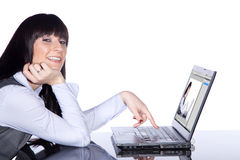 Woman pointing at laptop Royalty Free Stock Photography