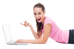 Woman pointing at laptop Stock Photography