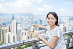 Woman pointing the location in Hong Kong Stock Photo