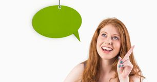 Woman pointing and looking at speech bubble icon Royalty Free Stock Photos