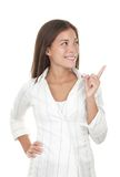Woman pointing and looking to the side Royalty Free Stock Images