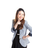 Woman pointing and looking to the side. Casual young businesswoman in white shirt looking, pointing and smiling at copy space. Young mixed race chinese / Royalty Free Stock Photo