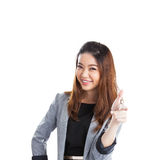 Woman pointing and looking to the side. Casual young businesswoman in white shirt looking, pointing and smiling at copy space. Young mixed race chinese / Stock Images