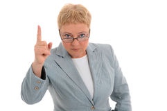 Woman pointing and looking at you Stock Photo