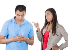 Woman pointing at man as if to say bad boy because he did something wrong Royalty Free Stock Photo