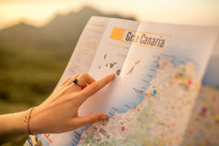Woman pointing on the map of Gran Canaria island Stock Photo