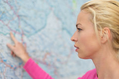 Woman pointing on map. Royalty Free Stock Photos