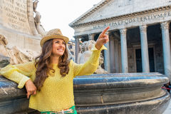 Woman pointing near fountain of the pantheon Royalty Free Stock Image