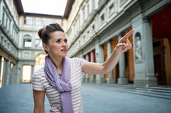 Woman pointing near uffizi gallery in florence Stock Photo