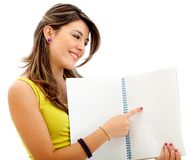 Woman pointing in a notebook Stock Photos