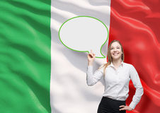 Woman is pointing out the blank speech bubble. Royalty Free Stock Image
