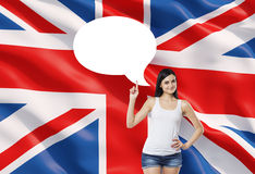 Woman is pointing out the empty thought bubble. Great Britain flag as a background. Stock Photography