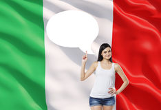 Woman is pointing out the empty thought bubble. Italian flag as a background. Stock Photos