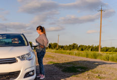Woman pointing out the way to a female driver Stock Photography