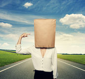Woman pointing at paper bag on the head Royalty Free Stock Images