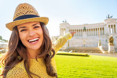 Woman pointing on piazza venezia in rome, italy Stock Images