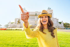 Woman pointing while on piazza venezia in rome Stock Images