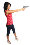 Woman pointing a pistol. Attractive hispanic woman holding a pistol ready to shoot on a white background Royalty Free Stock Photos
