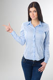 Woman pointing Royalty Free Stock Photo
