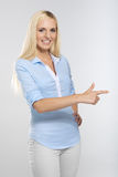 Woman pointing Royalty Free Stock Photography