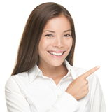 Woman pointing portrait isolated Stock Images